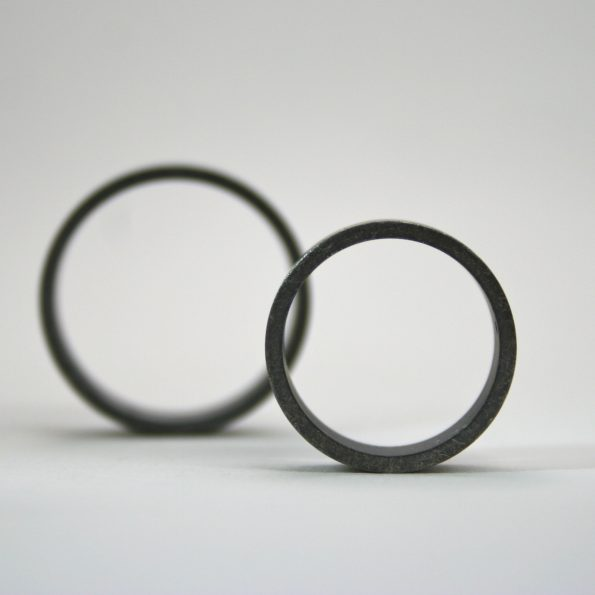 rough finish ring set with black diamonds