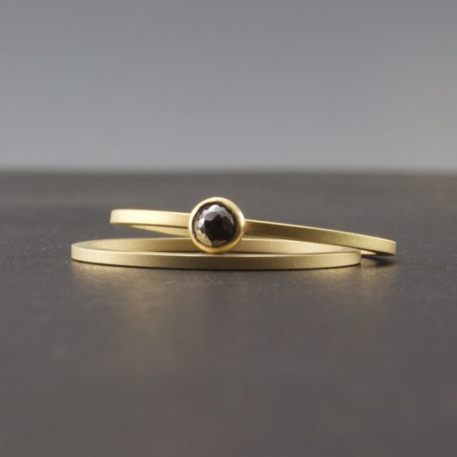gold and black diamond rings